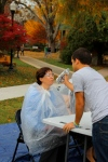 Assistant professor Adriana Dinescu prepared to be pied.