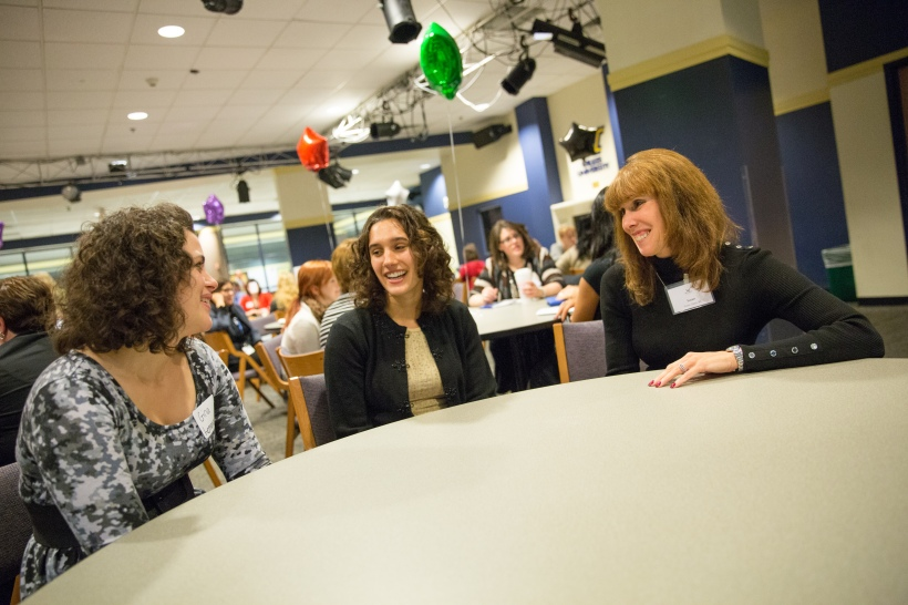 Susan Maier Davis '85, right, and her mentees Gina Lemoncelli, a junior nursing major, and Carly Cappello '13 talk about the nursing profession together at a recent Wilkes event.