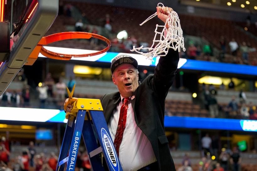 Wisconsin Badgers coach Bo Ryan '69 cuts down the net after his team's win over Arizona secured their spot in the Final Four.  Photo courtesy of the University of Wisconsin.