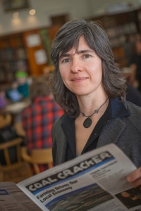 Krista Gromalski '91 recalls her roots in the coal region with her youth newspaper. PHOTO BY CHUCK ZOVKO