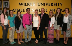 Members of the women' soccer team gather to thank Susan Dalton St. Onge '91 and her husband, Kevin, for their gift supporting refurbishment of their locker room. Pictured from left are Shelby Trumbo, sophomore; Olivia Schlottmann, sophomore, Erin Donnelly '14, graduate assistant coach; John Sumoski, head women's soccer coach; Susan Dalton Saint Onge '91; Kevin Saint Onge; Sarah Wasley, senior; Megan Binder, senior; Kate Mahoney, senior.